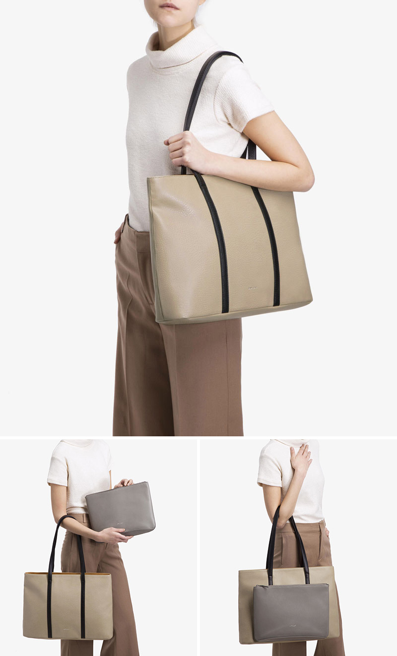 This modern sophisticated tote has two bags in one - the tote and a removable front clutch, both made from vegan leather