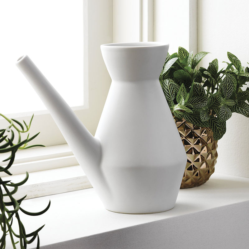 The lack of a handle on this watering can gives it a modern design that's still easy and comfortable to use because of the narrow neck and long spout.
