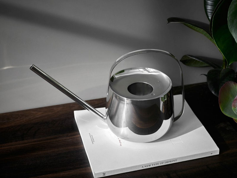 This modern watering can is made from a polished metal, giving it a constant shine that will have you wanting to display it just as much as your plants.