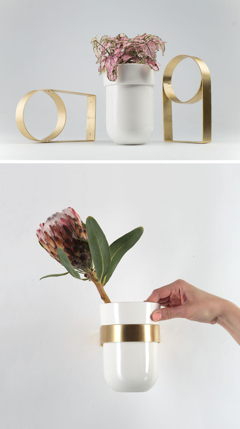 This modern ceramic white vase can be attached to a wall using a special brass wall mount.