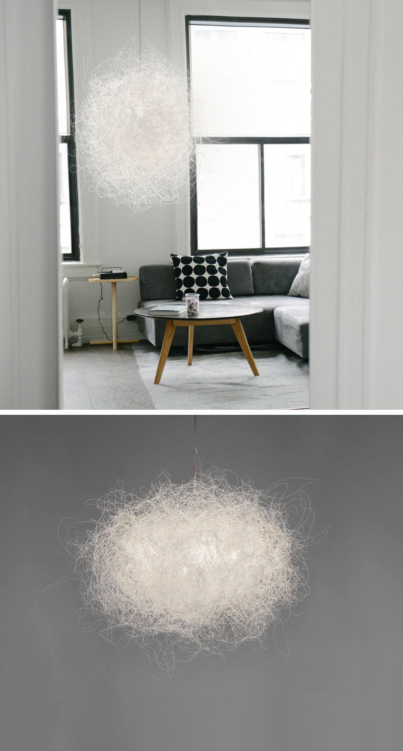 Arturo Alvarez has designed Pili, a modern decorative pendant lamp, that's made from a single, white painted stainless steel thread.