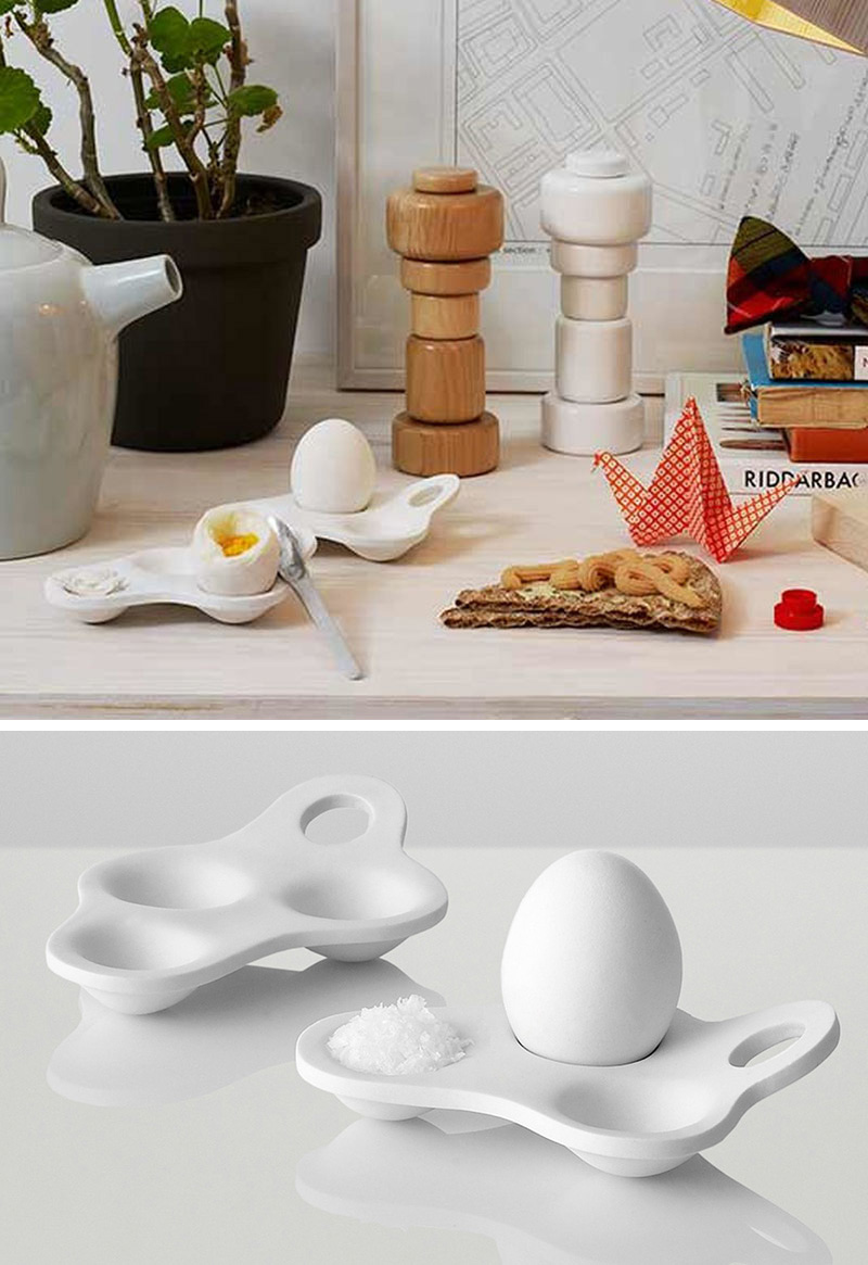 This modern white egg holder was designed with three grooves in it to accommodate an egg and two other ingredients, like salt or ketchup, making it perfect for people who like a little extra flavour with their egg.
