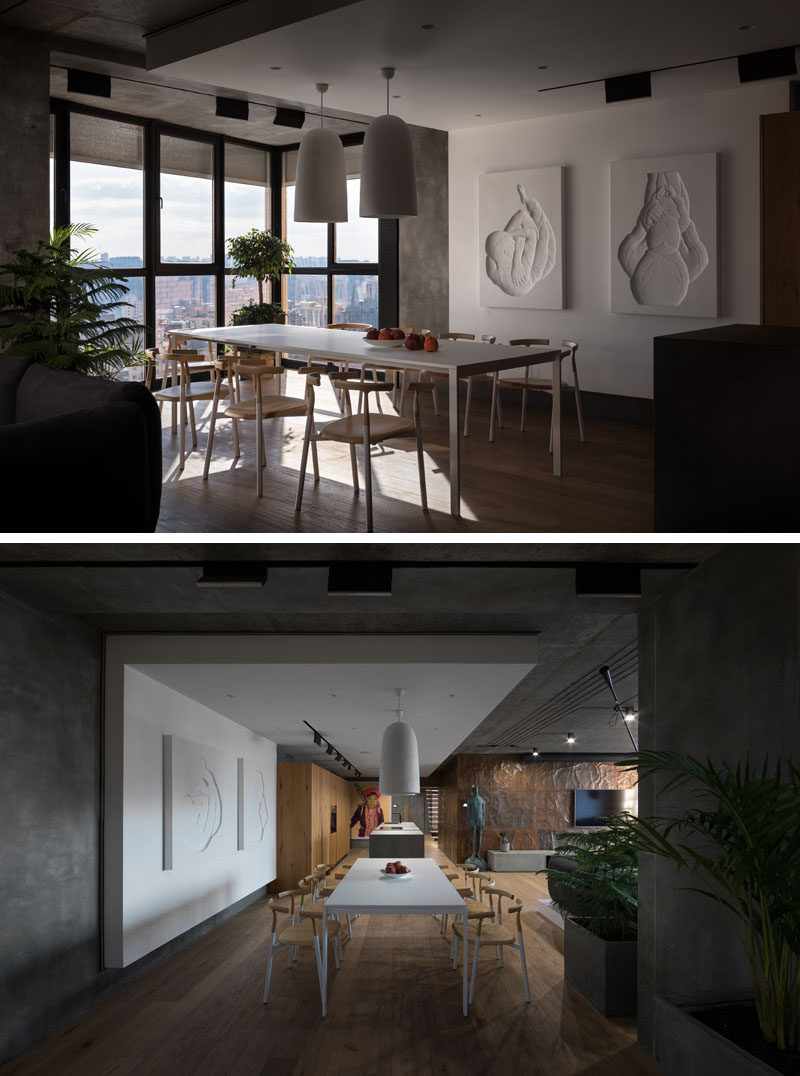 In this modern dining room, the simplistic dining set compliments the wood flooring and accents found throughout the rest of the home. By locating the dining room beside the windows, natural light fills the room and provides a view of the city while enjoying a meal.