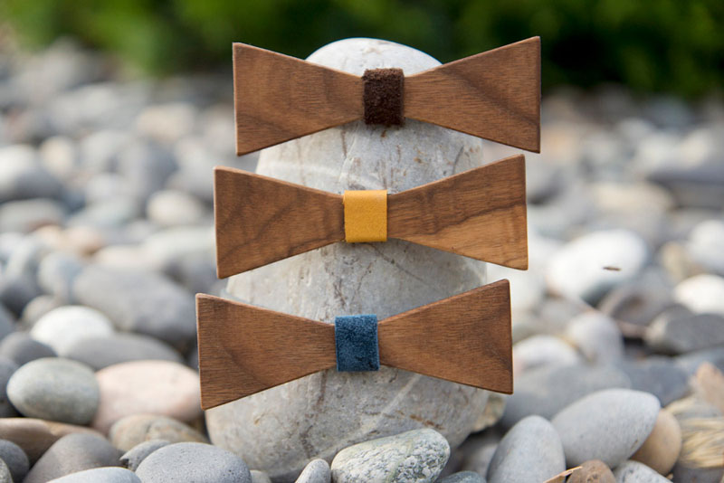 These angular, modern wood bow ties feature warm leather center pieces which add a little bit of color to the simple design, making them more unique for men's fashion.