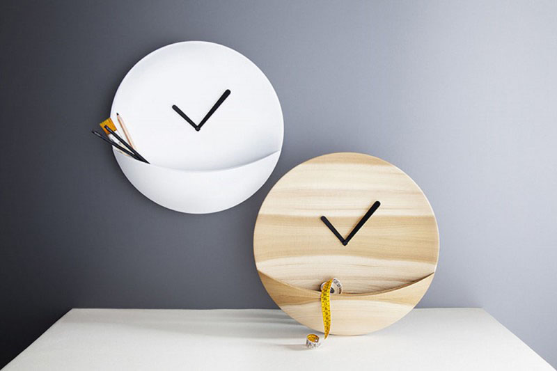 The small pocket at the bottom of these modern, circular wood wall clocks was inspired by kangaroo pouches and creates the perfect spot to tuck a few things that don't fit in elsewhere.