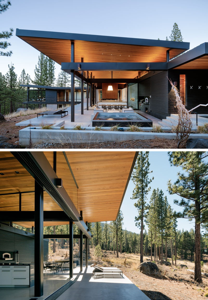 The main floor of this modern house opens up to an outdoor area with hot tub, surrounded by a concrete patio with multiple seating arrangements, making this space a great spot to lounge and enjoy the outdoors.