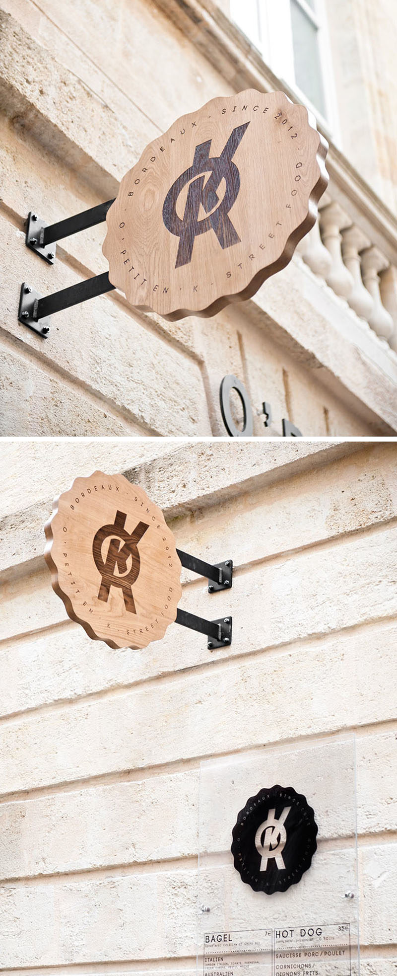 The logo for the street food brand O'Petit en'K has been burned into this round sign creating a dark contrast on the light wood.