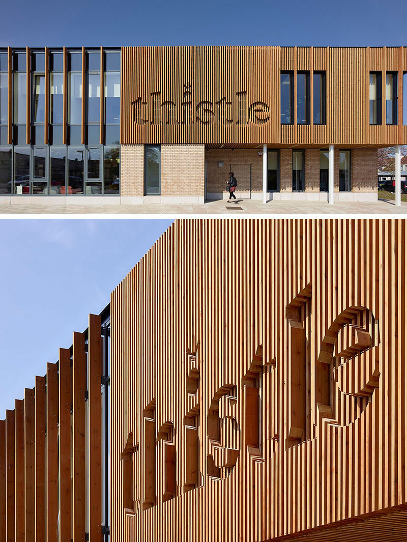 the wood logo on the exterior of this wellness centre has been integrated into the wood siding - Wood Sign Design Ideas
