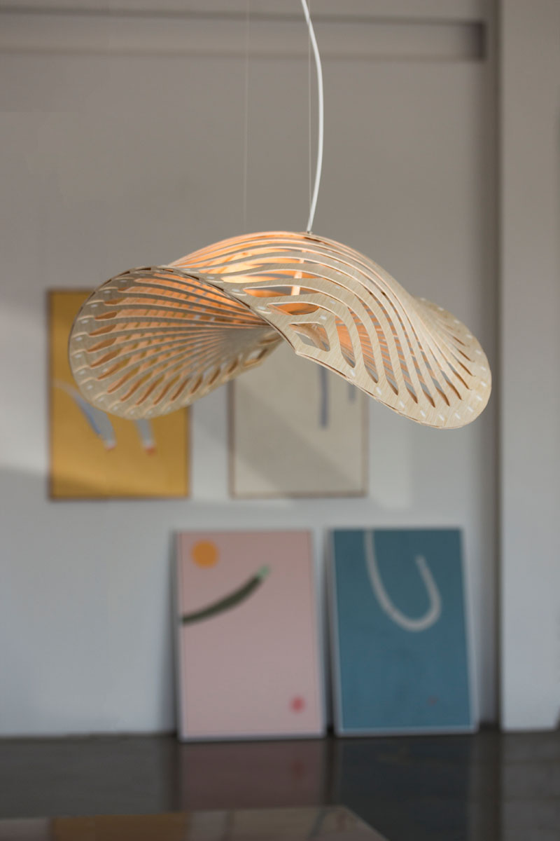 Inspired by the microscopic organisms living in our oceans, New Zealand-based designer David Trubridge has created Navicula - a modern and sculptural light fixture made from CNC cut bamboo plywood.