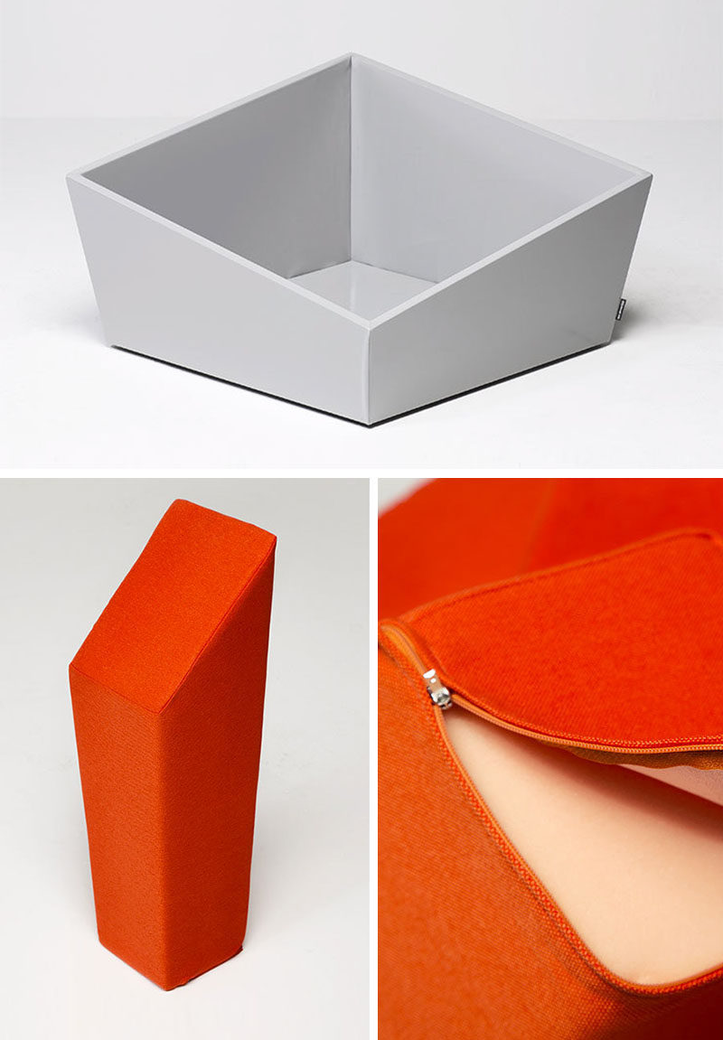 The design of this sculptural seat allows you to place the numerous orange cushions in any order within the white box frame.