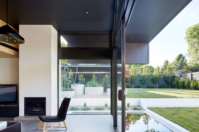 This modern living room has a fireplace and large sliding door can be opened on a nice day.