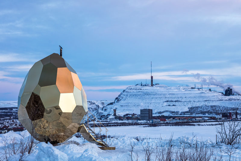 A Sauna Disguised As A Golden Egg Sits In The Landscape Of Sweden