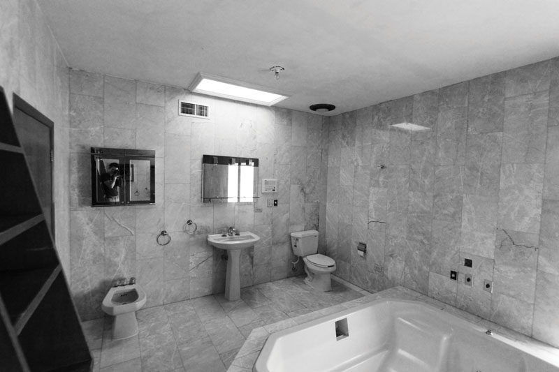 This is the before photo of a bathroom that received a modern renovation.