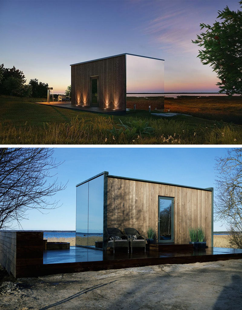Prefabricated mirrored glass on three sides of this modern home reflect the surrounding areas, making the house blend in with nature. The front entrance can be found at the back of the home, which is made from wood.