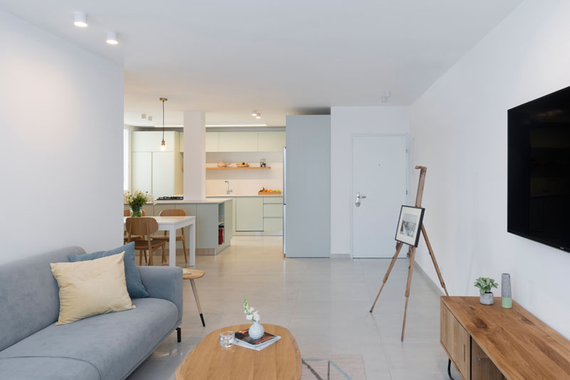 In this modern apartment, an open layout reveals different areas. Smooth light colored flooring continues throughout the home.