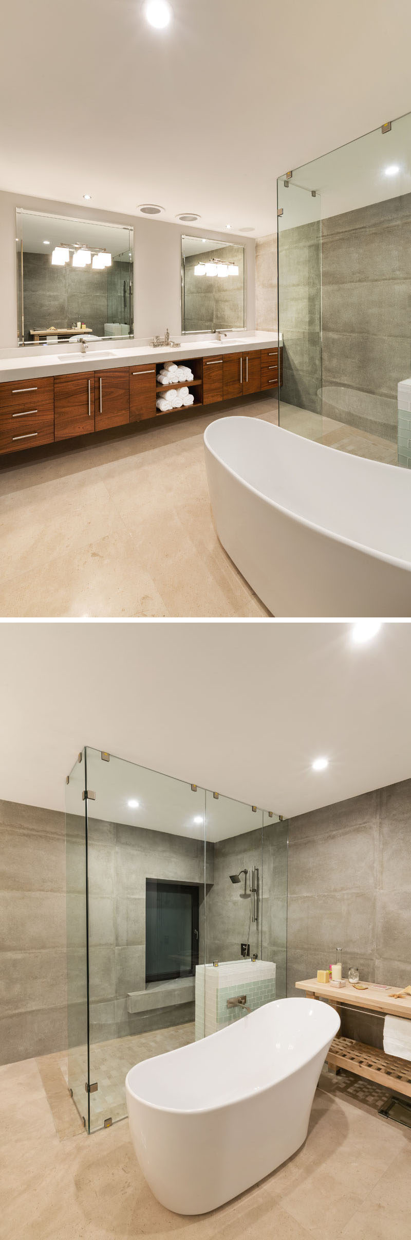 In this newly updated modern bathroom, marble tiles on the walls were removed and replaced by imported porcelain tiles. The bathtub is central to the bathroom, while the shower has a floor-to-ceiling glass surround, and a large wood vanity with dual sinks runs the length of one wall. Large mirrors help to reflect the light throughout the room.