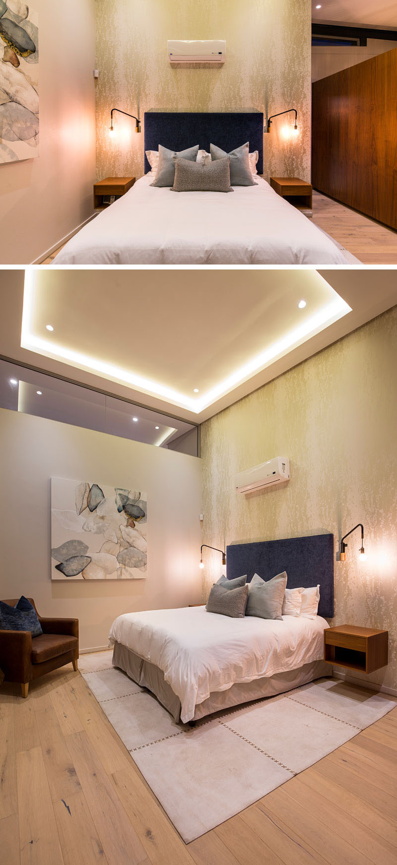 In this modern master bedroom, gold wall paper behind the blue upholstered headboard reflects light from the wall mounted lights on either side of the bed, and the hidden lighting in the recessed ceiling.