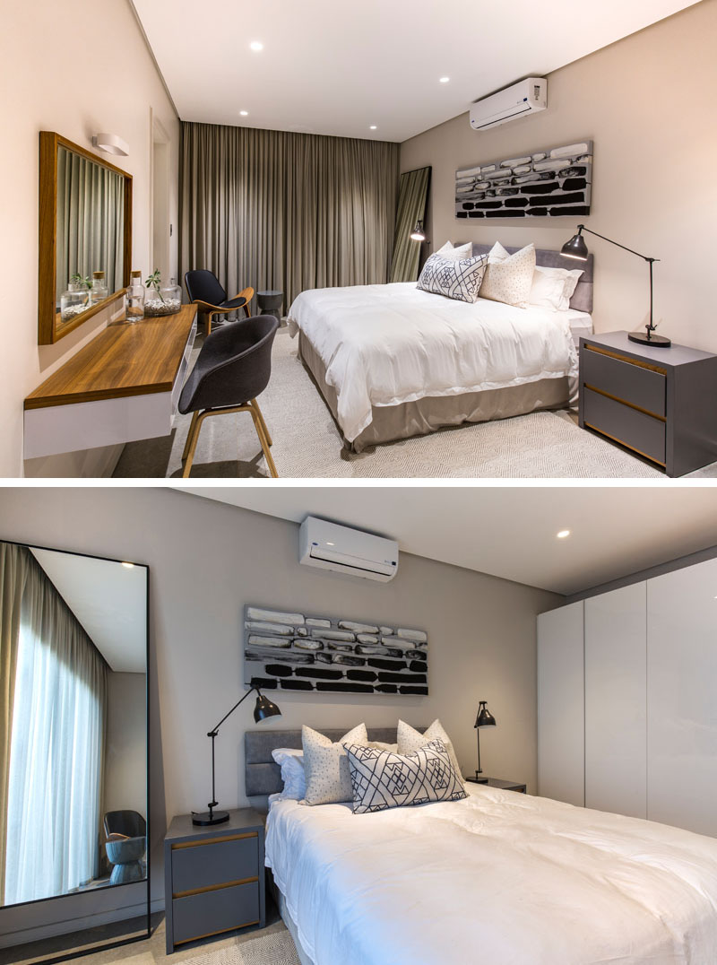 In hues of grey, black, and white, this modern guest bedroom is modern in design. The dark grey bedside tables, and the large light colored wardrobe, provide plenty of storage in this room.