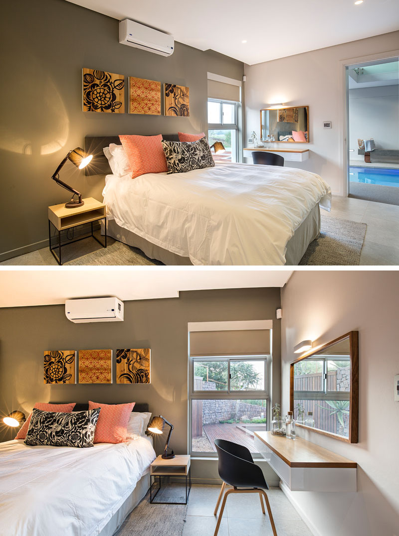 In this modern bedroom, wood bedside tables compliment the mounted art pieces that hang above the bed, while the color in the pieces compliment with the bedding and decor. A window beside the floating desk provides extra lighting in this guest bedroom.