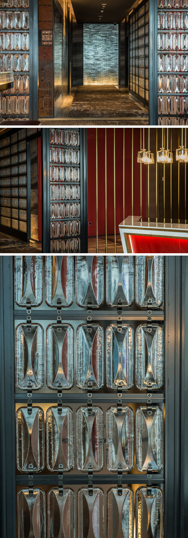 Decorative glass elements lead this modern hotel bar, which is adorned in red, black, and copper components, creating an slightly modern industrial atmosphere.