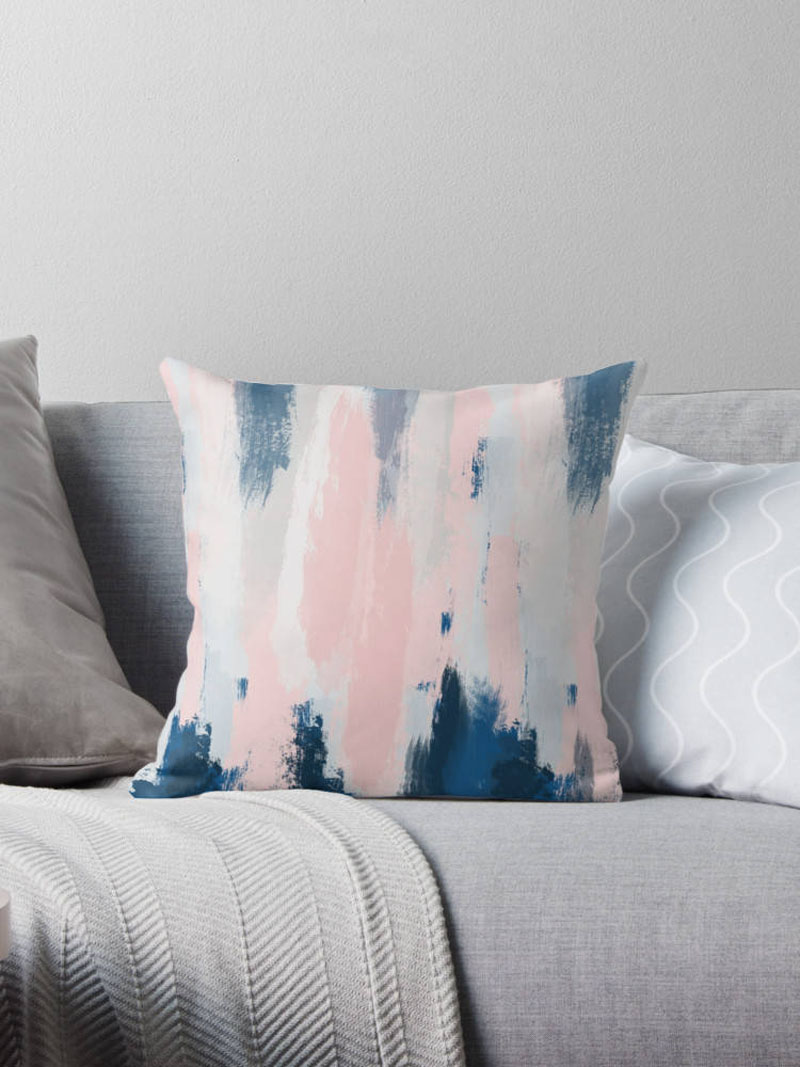 Fresh and fun, this modern pillow cover has an abstract print that features blush pink.