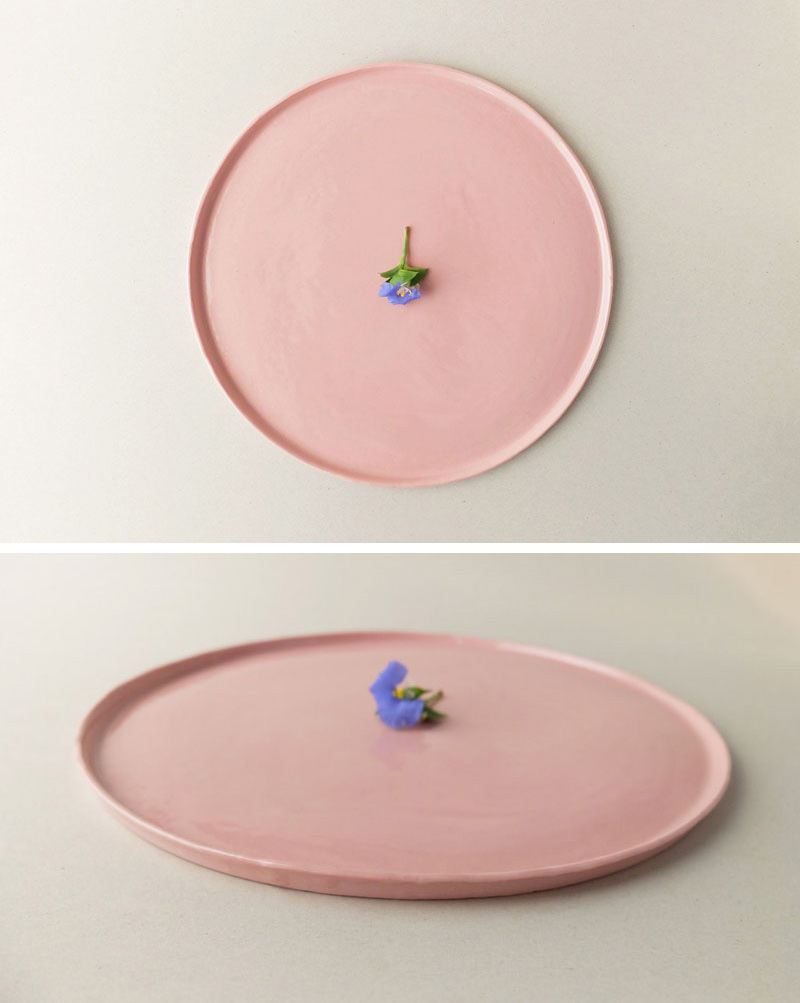 Perfect for food or as a base for ornaments, this modern large blush pink ceramic dinner plate has an elevated rim and is handmade.