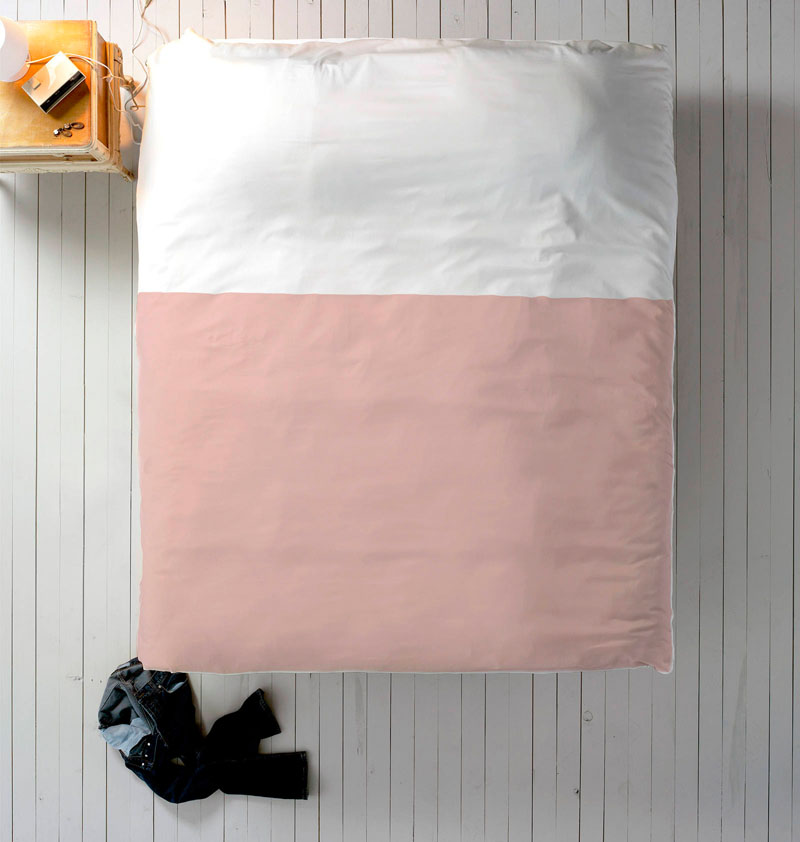 A modern bedroom makeover is made easy with this white and blush pink duvet cover.