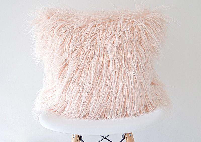 Instantly make any sofa or chair extra cozy with this modern blush pink faux fur pillow cover.