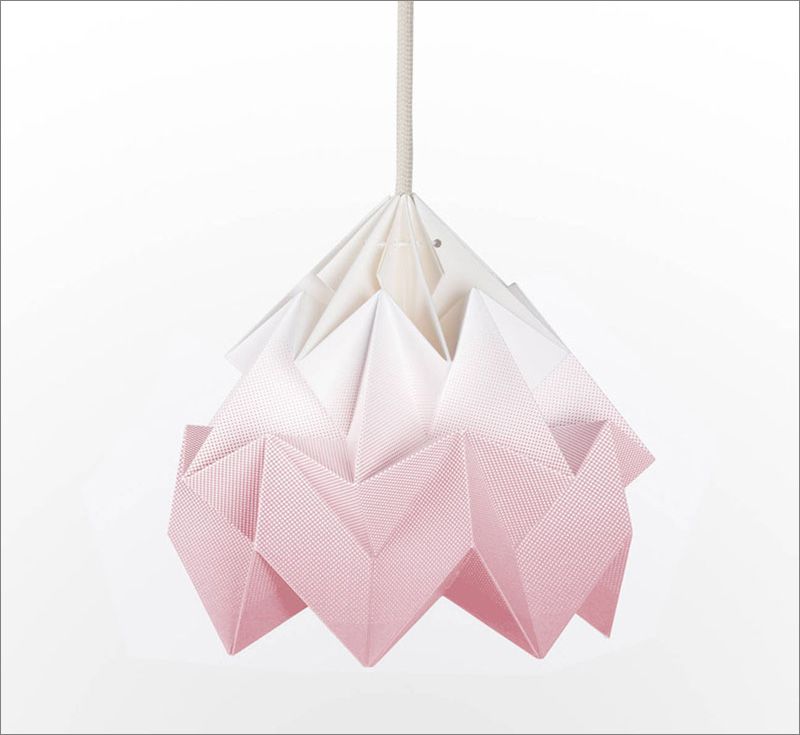 This blush pink origami pendant light with intricate folds, creates a warm glow in any room.
