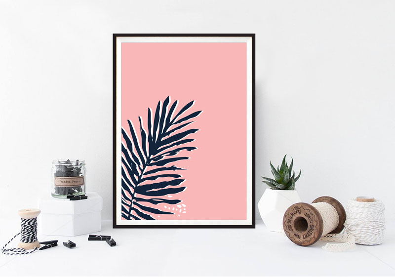 This blush pink tropical wall art print will stand out on any wall.