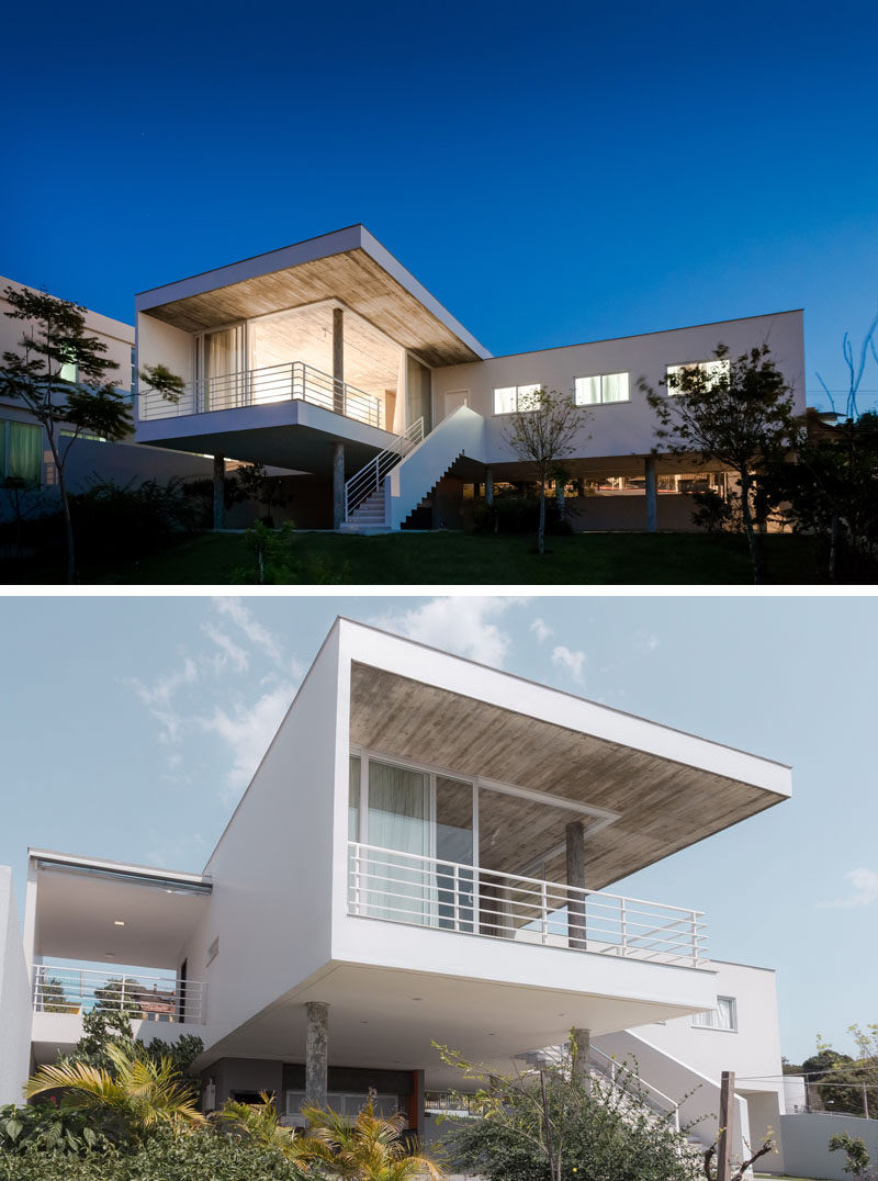 From the backyard of this modern house, it's easy to see that it sits above the ground, creating a void underneath the home..