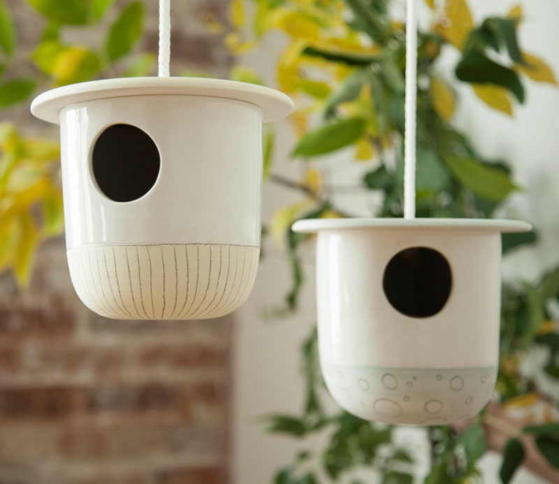 This ceramic birdhouse features a delicate hand painted pattern on the lower portion and a transparent glaze making it durable for outdoor use.