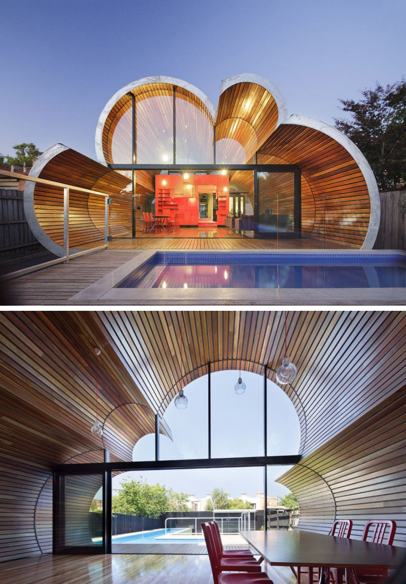 The glass patio doors along with the curved windows of the modern Cloud House, create a floor-to-ceiling view of the backyard.