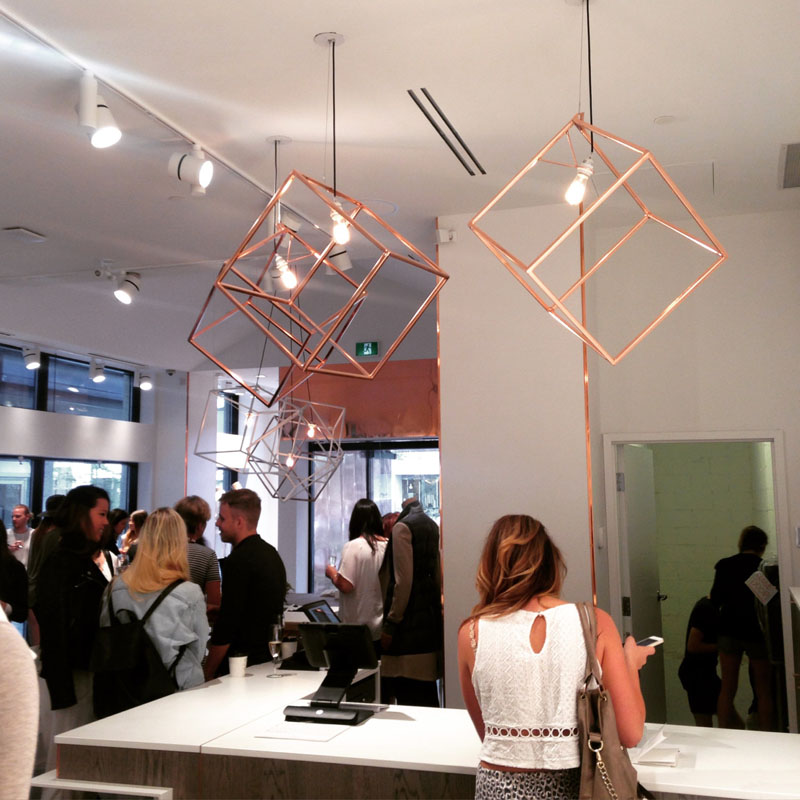 Modern in design, these copper pendant lights makes a bold statement in any space due to it's large size and geometric form.