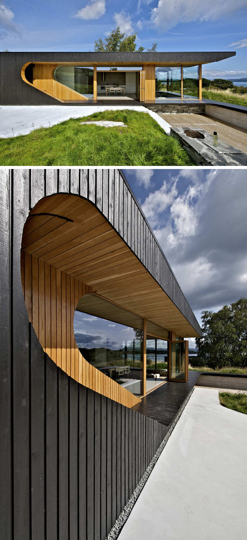 The curved window of this modern cabin follows the shape of the exterior, and reveals the interior of this black wood cabin.