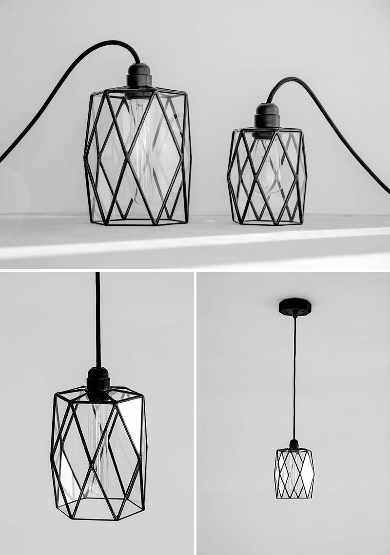 These modern glass pendant lights with black details look different geometrically from various angles.