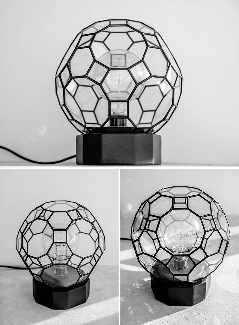 This modern circular black lamp is handmade from high quality materials like wood, glass and concrete, using traditional techniques of lamp making.