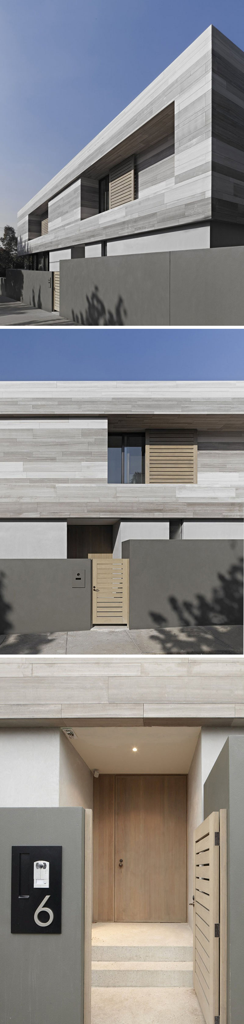 The exterior of this modern home is made from bands of travertine stone, that was collected from opposite sides of a quarry, giving it it's multiple grey tones. A light wood gate leads to the front entrance of the house.