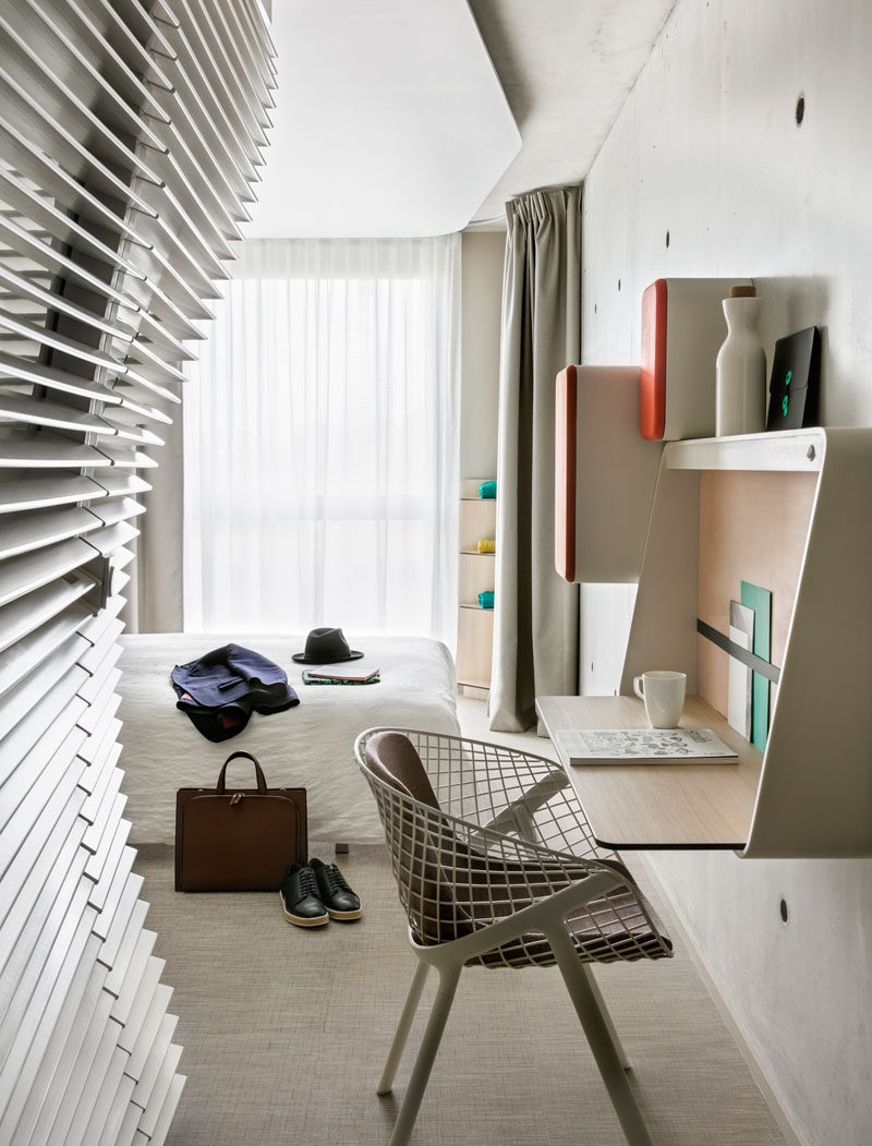 This modern hotel room features a wall mounted desk, ideal for when you need to get some work done when travelling.