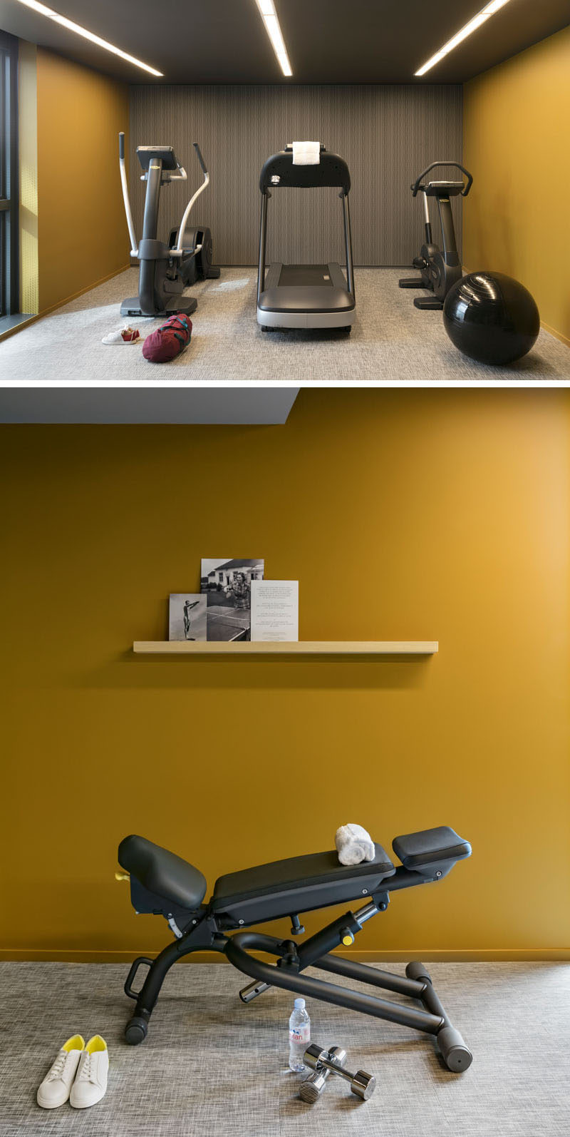 This modern hotel gym has a simple interior with bold colored walls and strips of lighting in the ceiling.