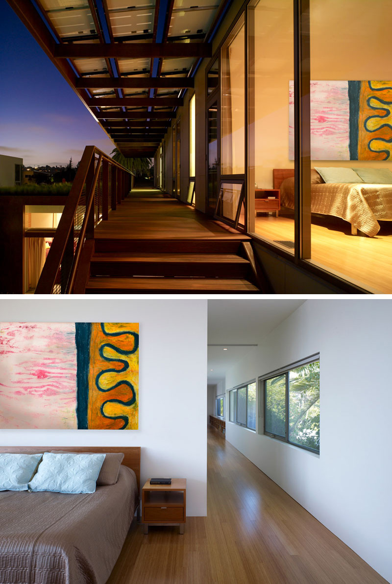 This modern wood walkway provides access to the bedrooms on the upper floor of the home.