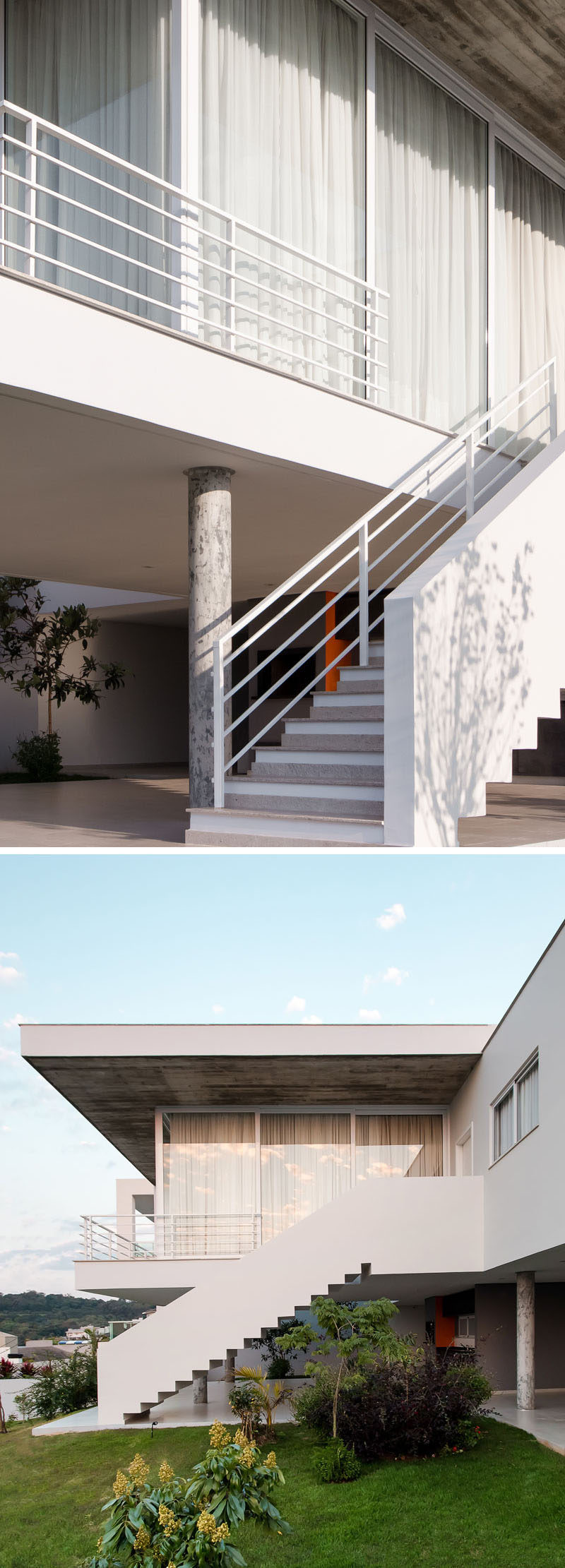 This house has white exterior concrete stairs that lead from the living area down to the backyard.