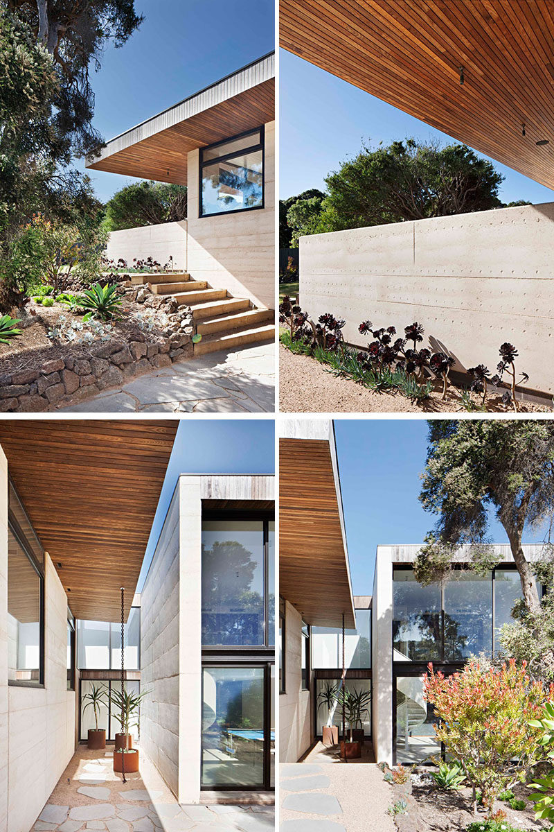 The two main building materials of this modern house are rammed earth for the walls, and timber used for the overhanging roof.