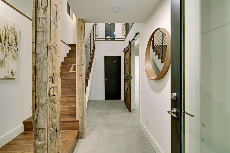 Arriving Inside The Home Interior Posts Have Been Made Into A Feature By Wring Them In 100 Year Old Hand Hewn Wood From Montana