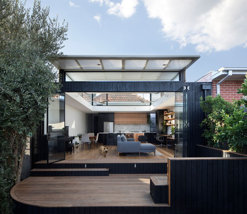 Ben Callery Architects have recently completed a contemporary extension to a brick house in Melbourne, Australia, that's home to a new open plan living space with a home office, dining area and kitchen.