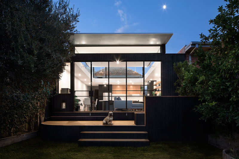 This modern house extension has the roof 'popped' up from the structure, and it allows for clerestory windows to let the light in and provides a view of the original home.