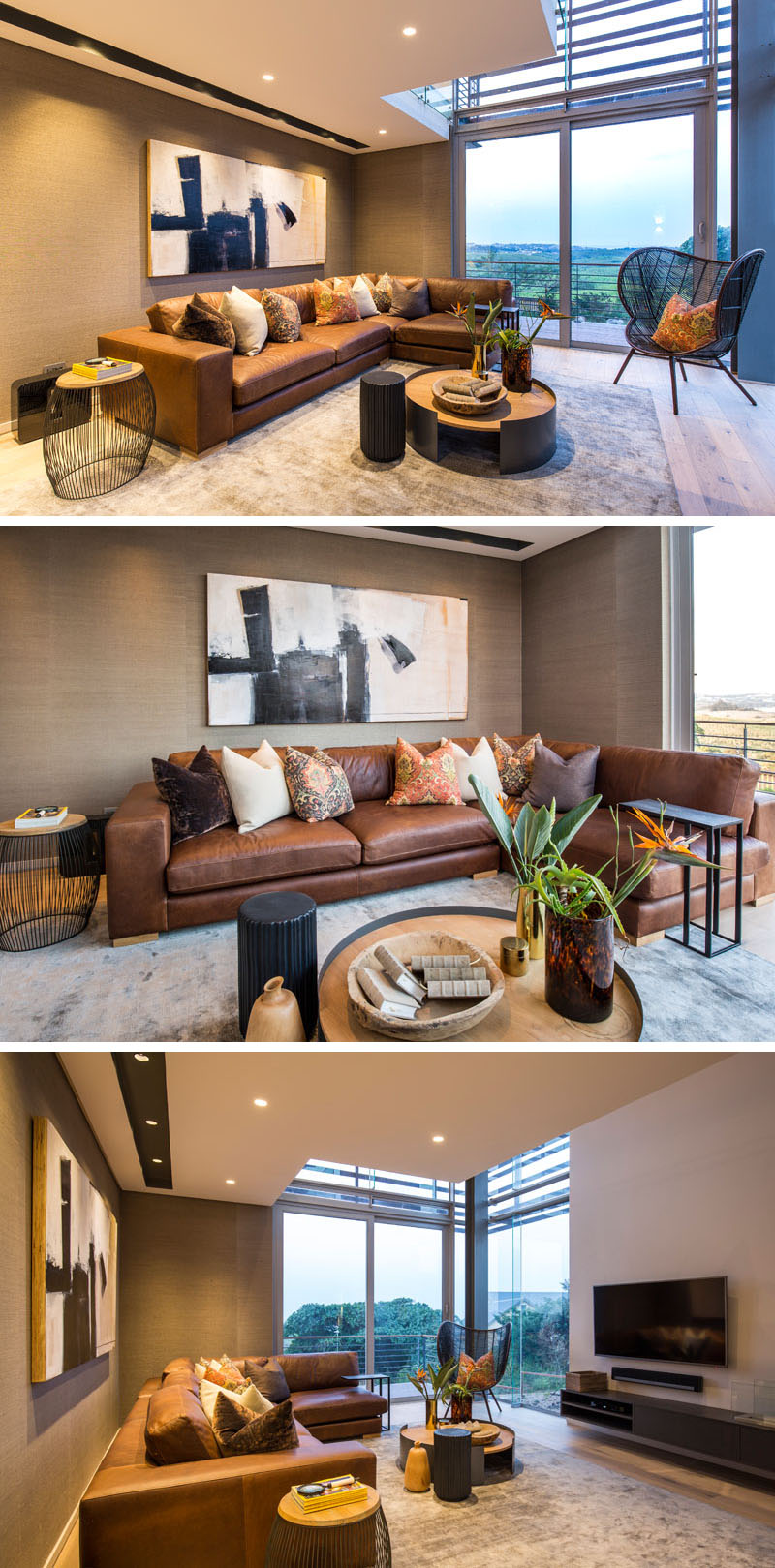 This modern living room, has a large L-shaped, brown leather couch and a black detailed chair provide seating. Warm earth tone colors used in the decor and fabrics, compliment the mounted art piece above the couch.