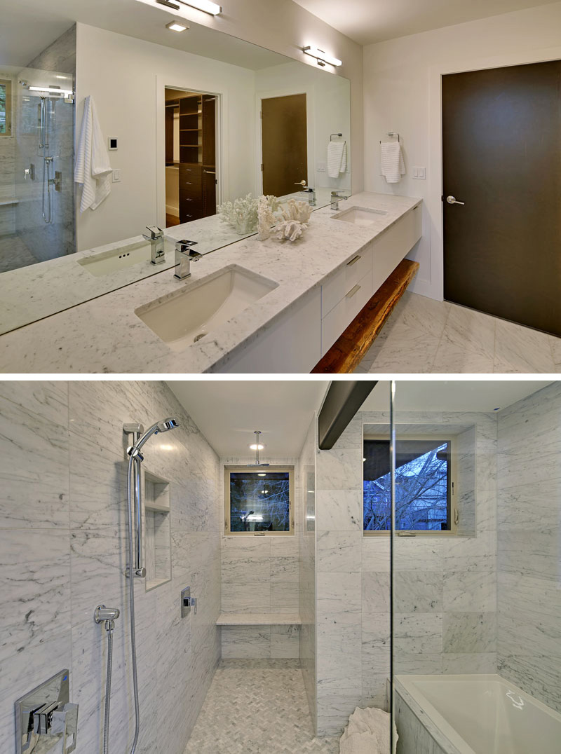 In this modern master bathroom, the counter, shower and bathtub surround are covered in carrara marble. Again, a maple shelf is used below the long counter that has his and her sinks.