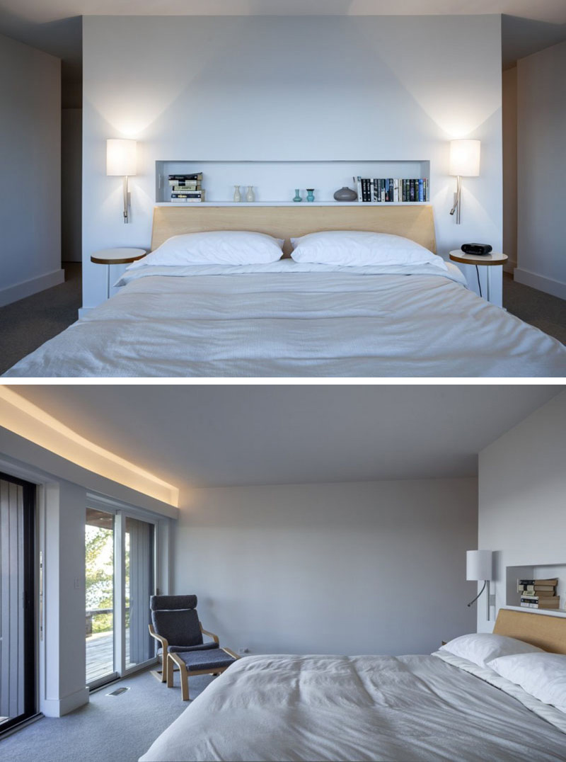 In this modern master bedroom, a built-in shelf above the bed provides an excellent space for books and small ornaments. Two wall mounted lamps provide reading light and sit above two wood nightstands. For extra light, hidden lighting is used again above the sliding glass doors in this room.