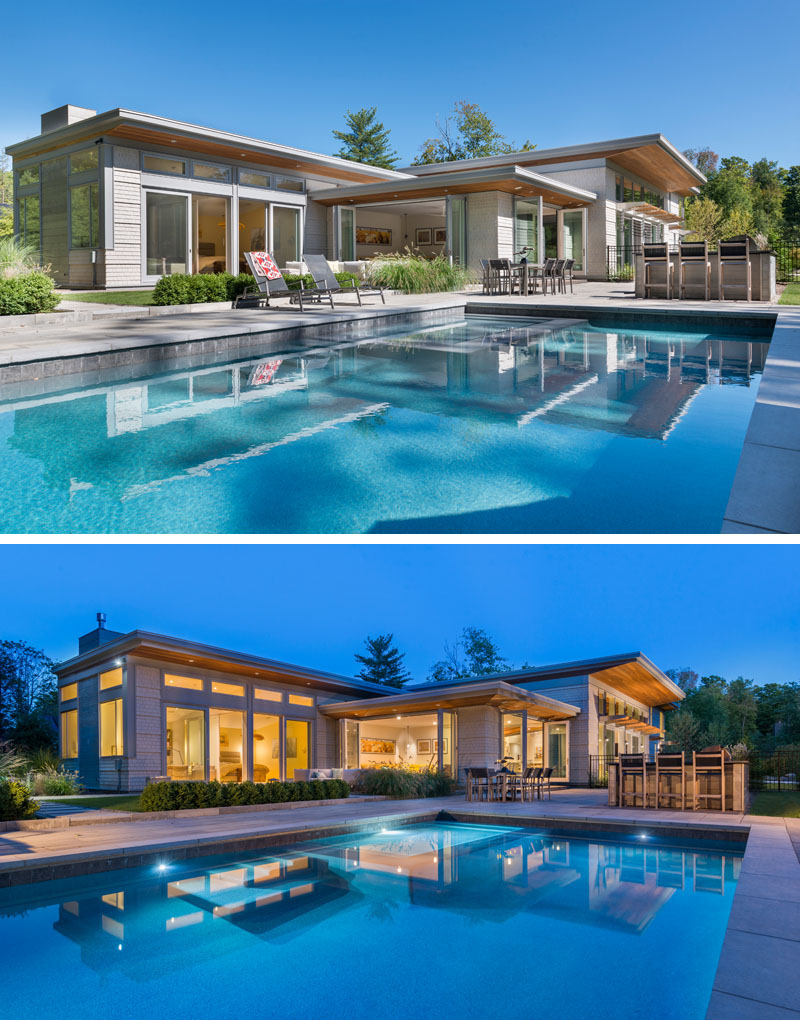 This modern house opens up to a backyard with a swimming pool, outdoor lounge, bar and dining area.
